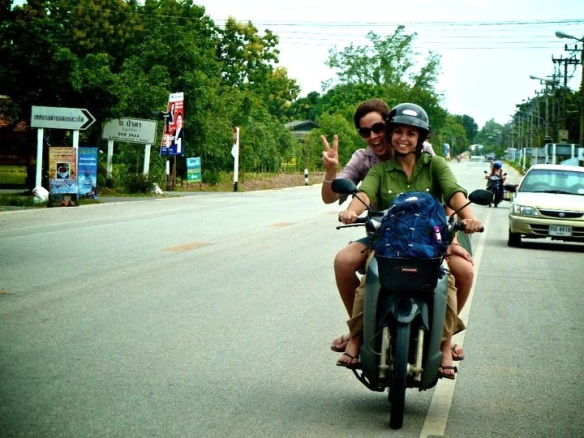 Sara on the back of a motorbike with volunteer Rachel