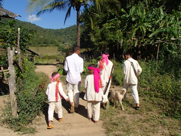 Boys in traditional dress walking to mountain site