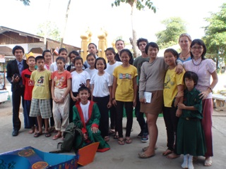 Anton with teachers, volunteers, and children after his school play production.